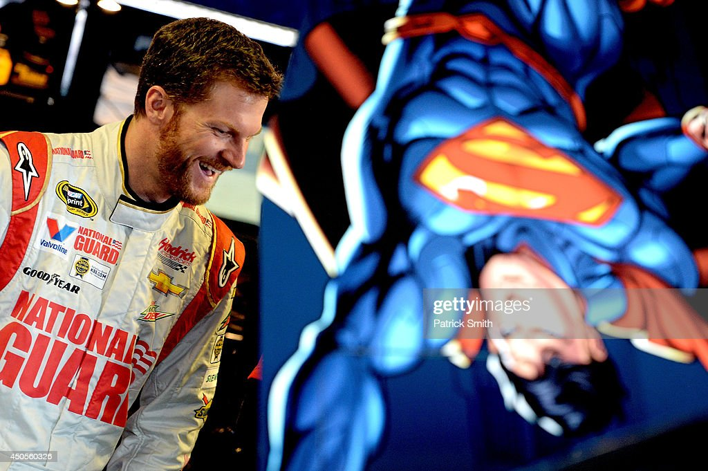 Dale Earnhardt Jr., driver of the #88 National Guard/Superman Chevrolet, stands in the garage area during practice for the NASCAR Nationwide Series Michigan 250 at Michigan International Speedway on June 13, 2014 in Brooklyn, Michigan.