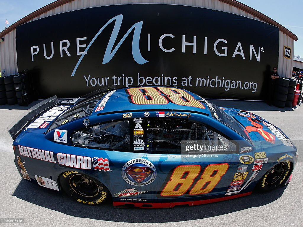 Dale Earnhardt Jr., driver of the #88 National Guard/Superman Chevrolet, drives through the garage area during practice for the NASCAR Sprint Cup Series Quicken Loans 400 at Michigan International Speedway on June 14, 2014 in Brooklyn, Michigan.