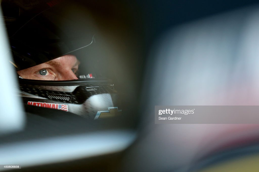 Dale Earnhardt Jr., driver of the #88 National Guard/Superman Chevrolet, sits in his car in the garage area during practice for the NASCAR Sprint Cup Series Quicken Loans 400 at Michigan International Speedway on June 14, 2014 in Brooklyn, Michigan.