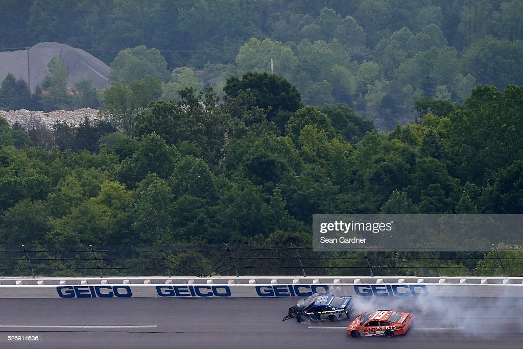 Dale Earnhardt Jr, driver of the #88 Nationwide Chevrolet, and Carl Edwards, driver of the #19 ARRIS Toyota, are involved in an incident during the NASCAR Sprint Cup Series GEICO 500 at Talladega Superspeedway on May 1, 2016 in Talladega, Alabama.