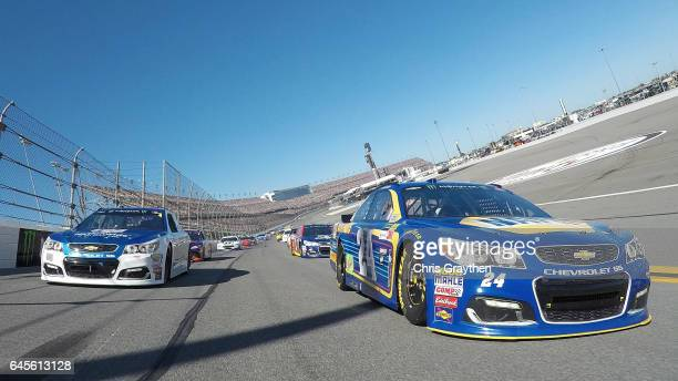 Dale Earnhardt Jr driver of the Nationwide Chevrolet and Chase Elliott driver of the NAPA Chevrolet lead the field prior to the 59th Annual DAYTONA...