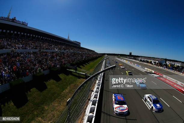 Dale Earnhardt Jr driver of the Nationwide Chevrolet and Chris Buescher driver of the Clorox Chevrolet lead a group of cars during pace laps prior to...