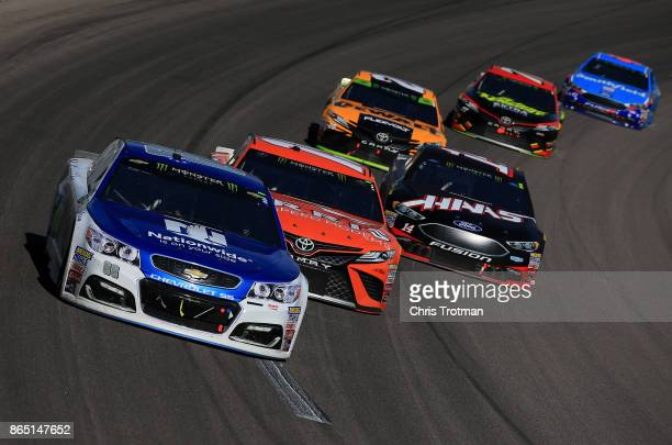 Dale Earnhardt Jr driver of the Nationwide Chevrolet and Daniel Suarez driver of the ARRIS Toyota leads a pack of cars during the Monster Energy...