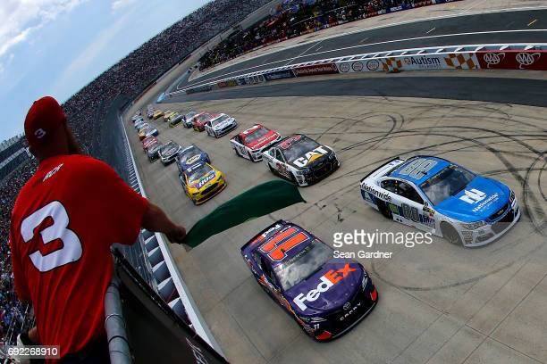 Dale Earnhardt Jr driver of the Nationwide Chevrolet and Denny Hamlin driver of the FedEx Express Toyota take the green flag during the Monster...