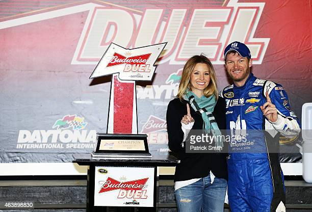 Dale Earnhardt Jr driver of the Nationwide Chevrolet and girlfriend Amy Reimann pose with the trophy in Victory Lane after winning the NASCAR Sprint...