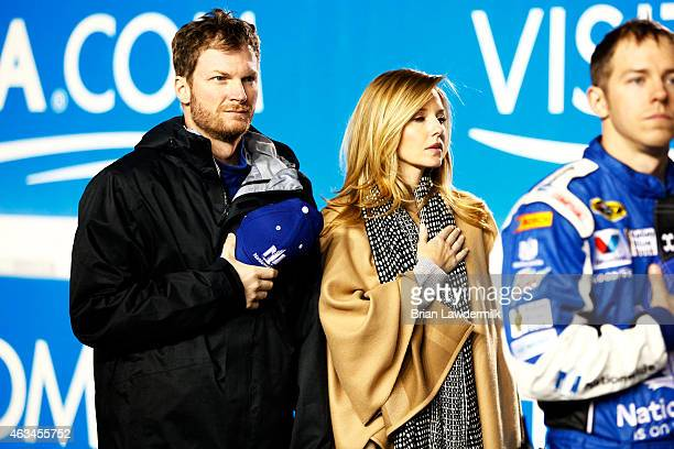 Dale Earnhardt Jr driver of the Nationwide Chevrolet and his girlfriend Amy Reimann stand on stage prior to the start of the 3rd Annual Sprint...
