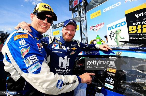 Dale Earnhardt Jr driver of the Nationwide Chevrolet and his crew chief Greg Ives celebrate in victory lane after winning the NASCAR Sprint Cup...