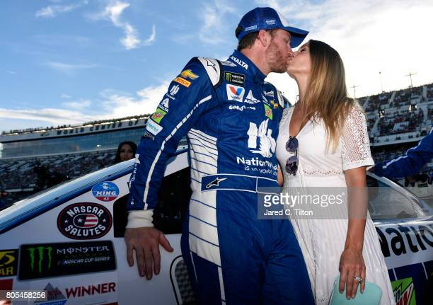 Dale Earnhardt Jr driver of the Nationwide Chevrolet and his wife Amy kiss on the grid prior to the Monster Energy NASCAR Cup Series 59th Annual Coke...