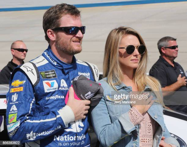 Dale Earnhardt Jr driver of the Nationwide Chevrolet and his wife Amy stand on the grid during the National Anthem prior to the Monster Energy NASCAR...