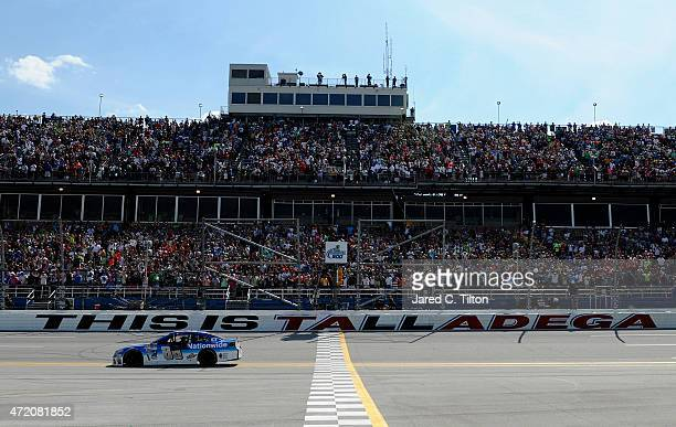 Dale Earnhardt Jr driver of the Nationwide Chevrolet celebrates after winning the NASCAR Sprint Cup Series GEICO 500 at Talladega Superspeedway on...