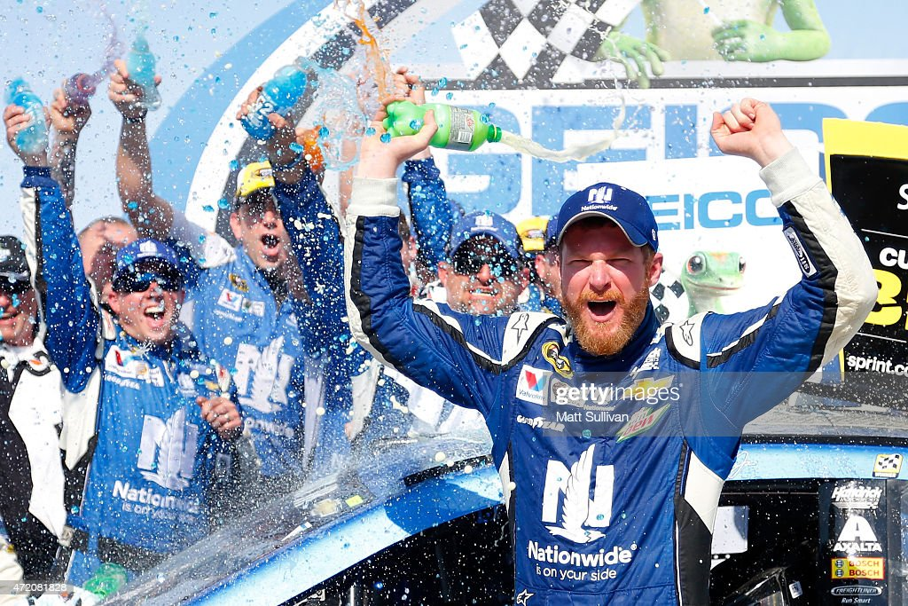 <a gi-track='captionPersonalityLinkClicked' href=/galleries/search?phrase=Dale+Earnhardt+Jr.&family=editorial&specificpeople=171293 ng-click='$event.stopPropagation()'>Dale Earnhardt Jr.</a>, driver of the #88 Nationwide Chevrolet, celebrates in victory lane after winning the NASCAR Sprint Cup Series GEICO 500 at Talladega Superspeedway on May 3, 2015 in Talladega, Alabama.