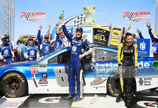 Dale Earnhardt Jr driver of the Nationwide Chevrolet celebrates in victory lane after winning the NASCAR Sprint Cup Series GEICO 500 at Talladega...