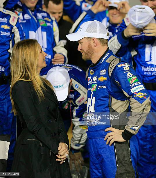 Dale Earnhardt Jr driver of the Nationwide Chevrolet celebrates in victory lane with his fiancee Amy Reimann after winning the NASCAR Sprint Cup...