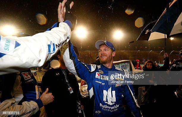 Dale Earnhardt Jr driver of the Nationwide Chevrolet celebrates on pit road after winning the rainshortened NASCAR Sprint Cup Series Quicken Loans...