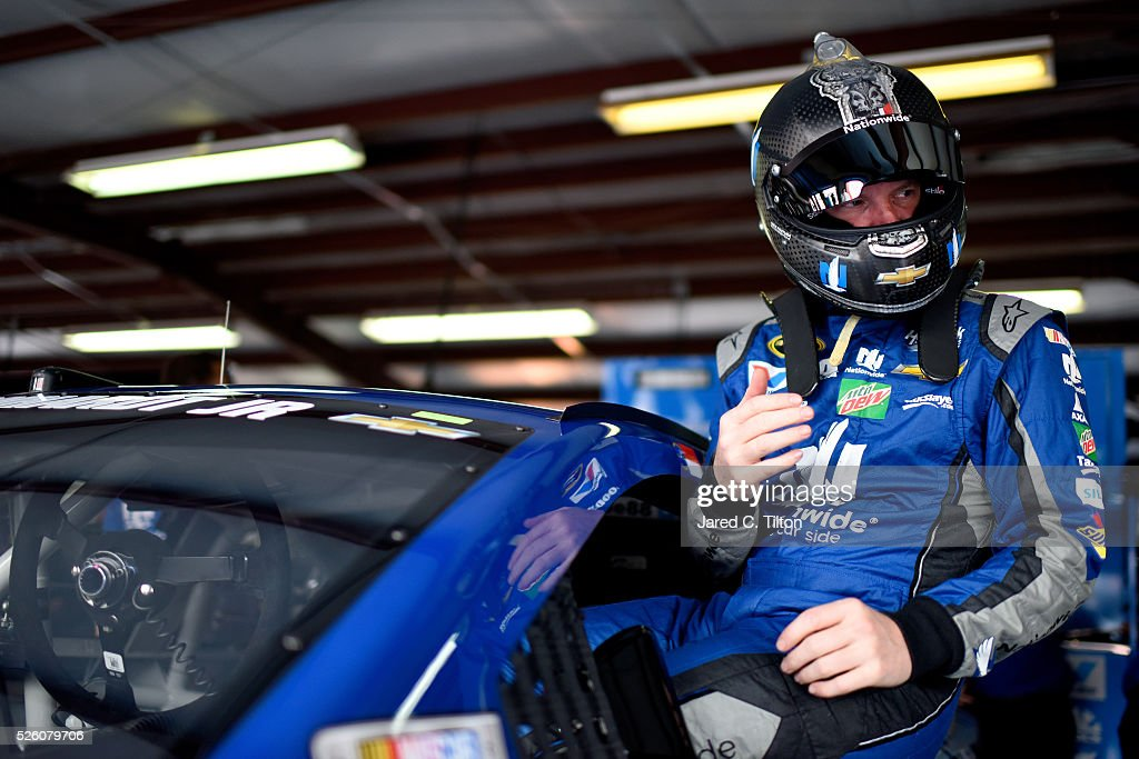 Dale Earnhardt Jr, driver of the #88 Nationwide Chevrolet, climbs into his car during practice for the NASCAR Sprint Cup Series GEICO 500 at Talladega Superspeedway on April 29, 2016 in Talladega, Alabama.