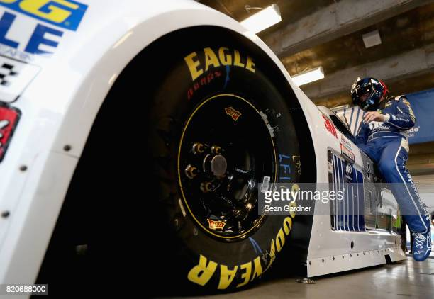 Dale Earnhardt Jr driver of the Nationwide Chevrolet gets into his car during practice for the Monster Energy NASCAR Cup Series Brickyard 400 at...