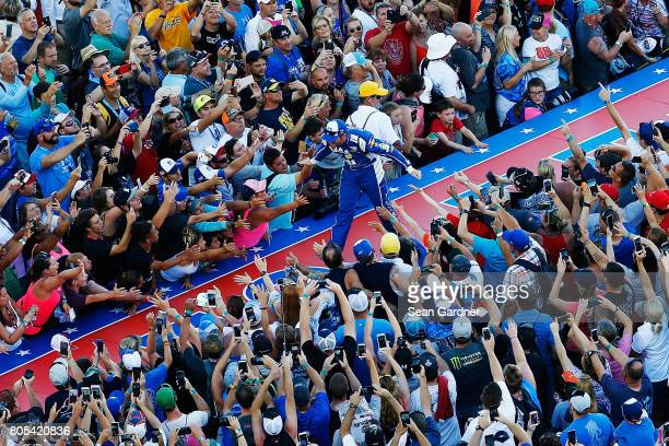 Dale Earnhardt Jr driver of the Nationwide Chevrolet greets fans as he is introduced prior to the Monster Energy NASCAR Cup Series 59th Annual Coke...