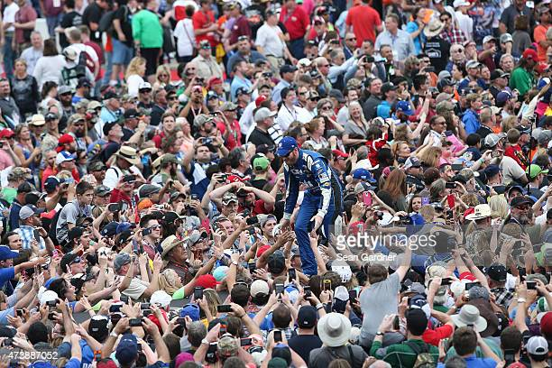 Dale Earnhardt Jr driver of the Nationwide Chevrolet greets fans during the NASCAR Sprint Cup Series Duck Commander 500 at Texas Motor Speedway on...