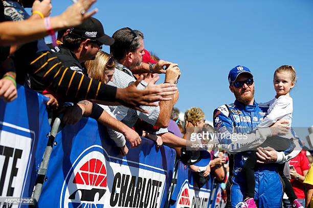 Dale Earnhardt Jr driver of the Nationwide Chevrolet greets fans prior to the NASCAR Sprint Cup Series Bank of America 500 at Charlotte Motor...
