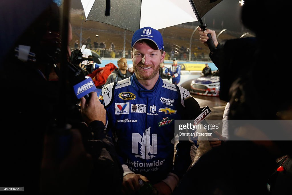 <a gi-track='captionPersonalityLinkClicked' href=/galleries/search?phrase=Dale+Earnhardt+Jr.&family=editorial&specificpeople=171293 ng-click='$event.stopPropagation()'>Dale Earnhardt Jr.</a>, driver of the #88 Nationwide Chevrolet, is interviewed on pit road after winning the rain-shortened NASCAR Sprint Cup Series Quicken Loans Race for Heroes 500 at Phoenix International Raceway on November 15, 2015 in Avondale, Arizona.