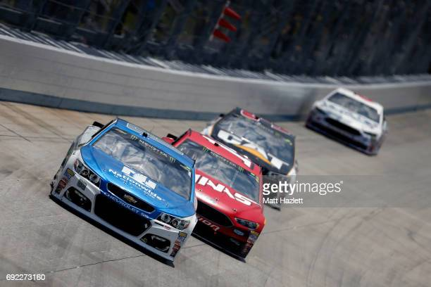 Dale Earnhardt Jr driver of the Nationwide Chevrolet leads a pack of cars during the Monster Energy NASCAR Cup Series AAA 400 Drive for Autism at...