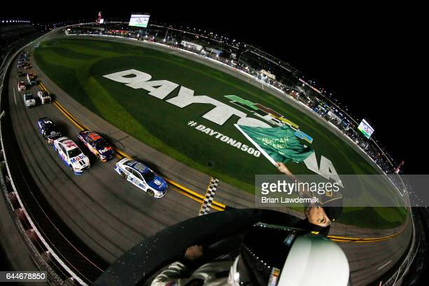 Dale Earnhardt Jr driver of the Nationwide Chevrolet leads the field to the green flag to start the Monster Energy NASCAR Cup Series CanAm Duel 2 at...