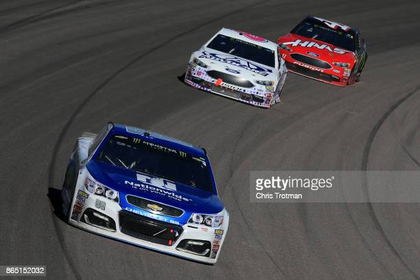 Dale Earnhardt Jr driver of the Nationwide Chevrolet leads Trevor Bayne driver of the AdvoCare Ford and Kurt Busch driver of the Haas...