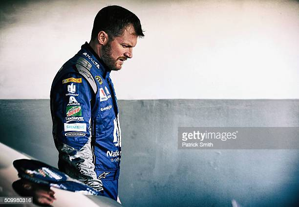 Dale Earnhardt Jr driver of the Nationwide Chevrolet looks on in the garage area during practice for the NASCAR Sprint Cup Series Daytona 500 at...