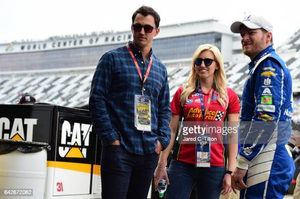 Dale Earnhardt Jr driver of the Nationwide Chevrolet poses for a picture with IndyCar driver Graham Rahal and his wife Courtney Force during practice...