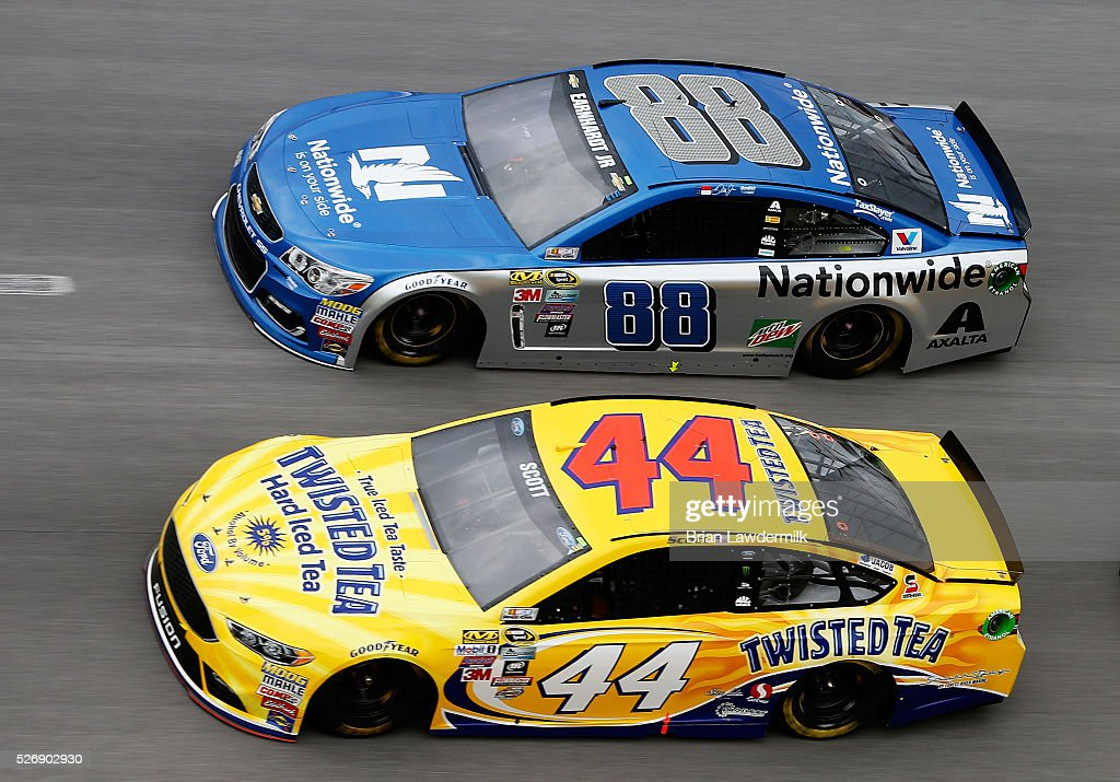 Dale Earnhardt Jr, driver of the #88 Nationwide Chevrolet, races <a gi-track='captionPersonalityLinkClicked' href=/galleries/search?phrase=Brian+Scott+-+Race+Car+Driver&family=editorial&specificpeople=12790118 ng-click='$event.stopPropagation()'>Brian Scott</a>, driver of the #44 Twisted Tea Ford, during the NASCAR Sprint Cup Series GEICO 500 at Talladega Superspeedway on May 1, 2016 in Talladega, Alabama.