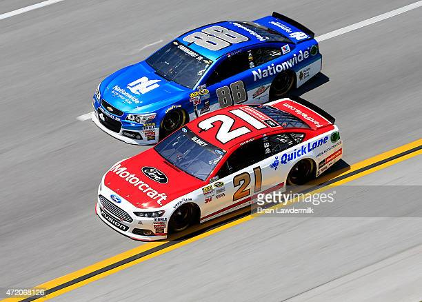 Dale Earnhardt Jr driver of the Nationwide Chevrolet races Ryan Blaney driver of the Motorcraft/Quick Lane Tire Auto Center Ford during the NASCAR...