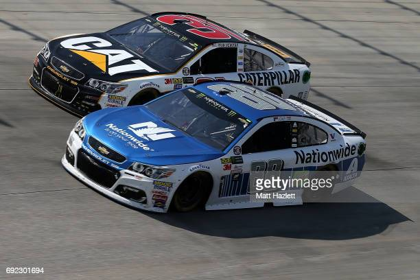 Dale Earnhardt Jr driver of the Nationwide Chevrolet races Ryan Newman driver of the Caterpillar Chevrolet during the Monster Energy NASCAR Cup...