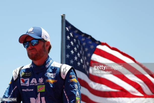 Dale Earnhardt Jr driver of the Nationwide Chevrolet rides on the back of a truck during driver introductions prior to the Monster Energy NASCAR Cup...