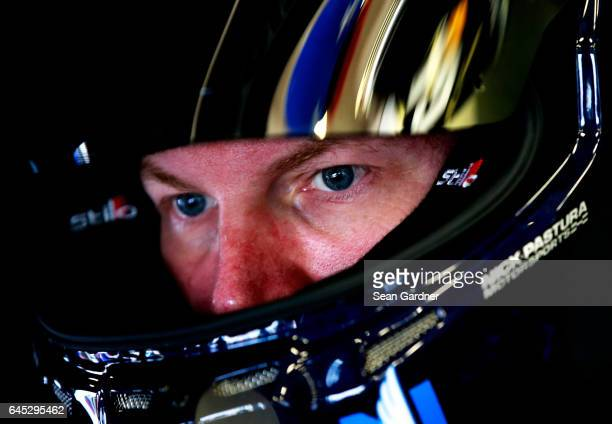 Dale Earnhardt Jr driver of the Nationwide Chevrolet sits in his car during practice for the 59th Annual DAYTONA 500 at Daytona International...