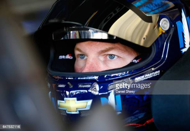 Dale Earnhardt Jr driver of the Nationwide Chevrolet sits in his car during practice for the Monster Energy NASCAR Cup Series Folds of Honor...
