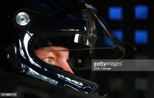 Dale Earnhardt Jr driver of the Nationwide Chevrolet sits in his car during practice for the Monster Energy NASCAR Cup Series Overton's 301 at New...