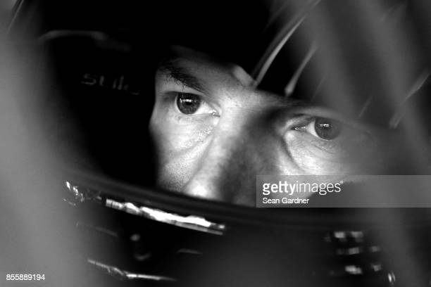 Dale Earnhardt Jr driver of the Nationwide Chevrolet sits in his car during practice for the Monster Energy NASCAR Cup Series Apache Warrior 400...