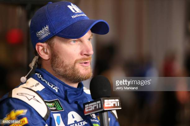 Dale Earnhardt Jr driver of the Nationwide Chevrolet speaks with ESPN with an upside down Monster Energy NASCAR Cup Series patch on his firesuit...
