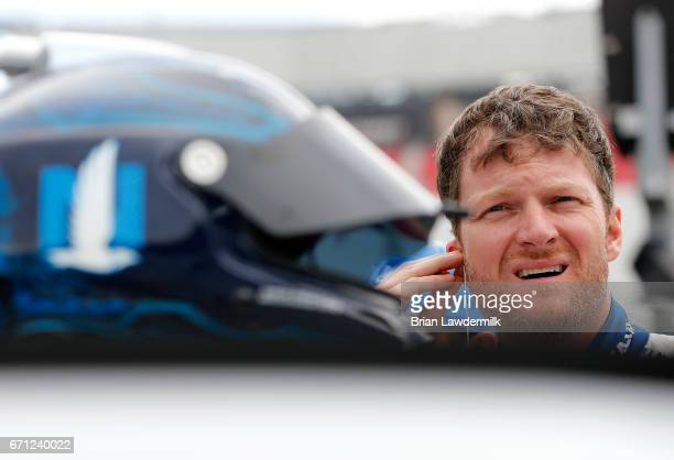 Dale Earnhardt Jr driver of the Nationwide Chevrolet stands by his car during practice for the Monster Energy NASCAR Cup Series Food City 500 at...