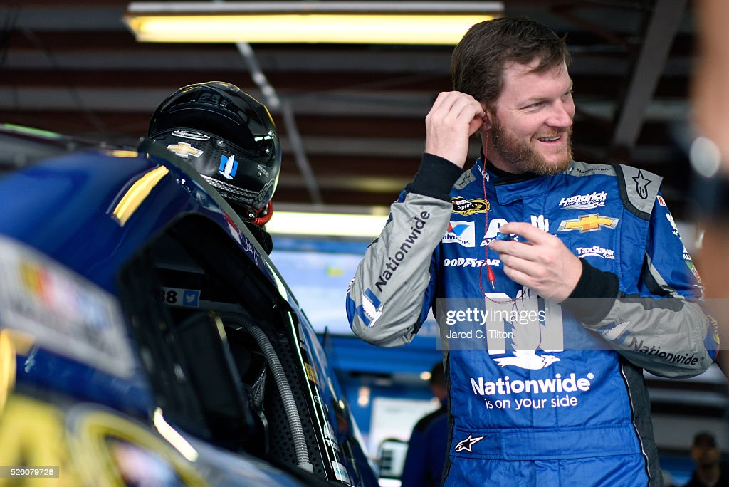 Dale Earnhardt Jr, driver of the #88 Nationwide Chevrolet, stands in the garage area during practice for the NASCAR Sprint Cup Series GEICO 500 at Talladega Superspeedway on April 29, 2016 in Talladega, Alabama.