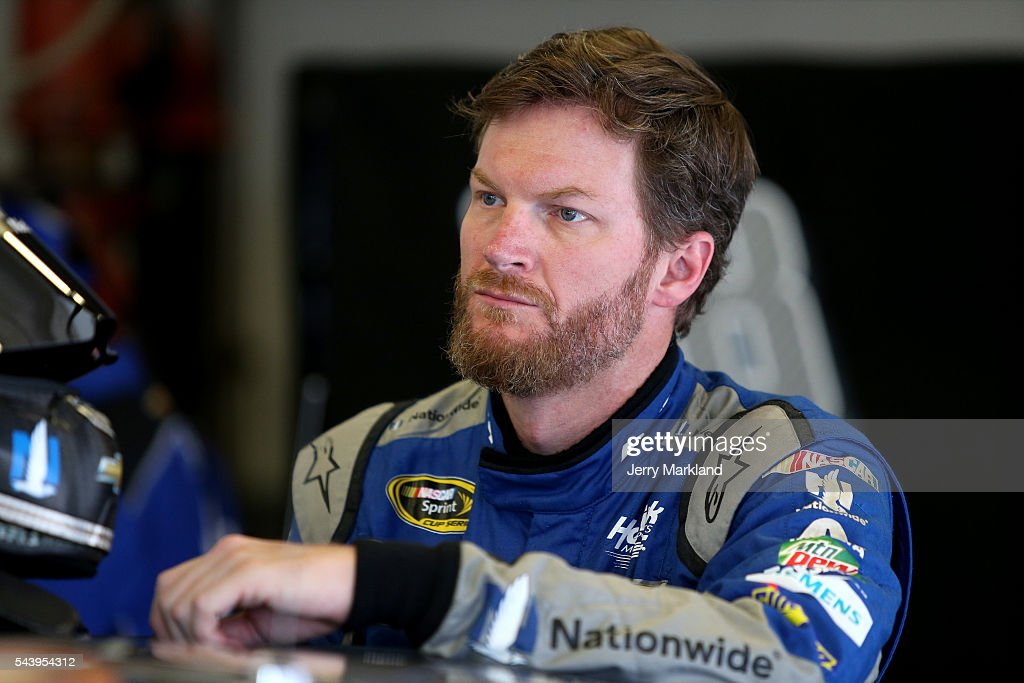 <a gi-track='captionPersonalityLinkClicked' href=/galleries/search?phrase=Dale+Earnhardt+Jr.&family=editorial&specificpeople=171293 ng-click='$event.stopPropagation()'>Dale Earnhardt Jr.</a>, driver of the #88 Nationwide Chevrolet, stands in the garage area during practice for the NASCAR Sprint Cup Series Coke Zero 400 at Daytona International Speedway on June 30, 2016 in Daytona Beach, Florida.