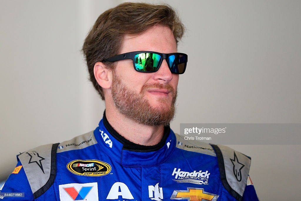 <a gi-track='captionPersonalityLinkClicked' href=/galleries/search?phrase=Dale+Earnhardt+Jr.&family=editorial&specificpeople=171293 ng-click='$event.stopPropagation()'>Dale Earnhardt Jr.</a>, driver of the #88 Nationwide Chevrolet, stands in the garage area during practice for the NASCAR Sprint Cup Series Coke Zero 400 at Daytona International Speedway on July 1, 2016 in Daytona Beach, Florida.