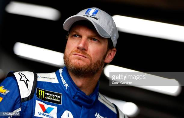 Dale Earnhardt Jr driver of the Nationwide Chevrolet stands in the garage area during practice for the Monster Energy NASCAR Cup Series GEICO 500 at...