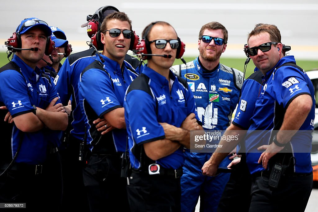 Dale Earnhardt Jr, driver of the #88 Nationwide Chevrolet, stands on the grid with his crew during qualifying for the NASCAR Sprint Cup Series GEICO 500 at Talladega Superspeedway on April 30, 2016 in Talladega, Alabama.