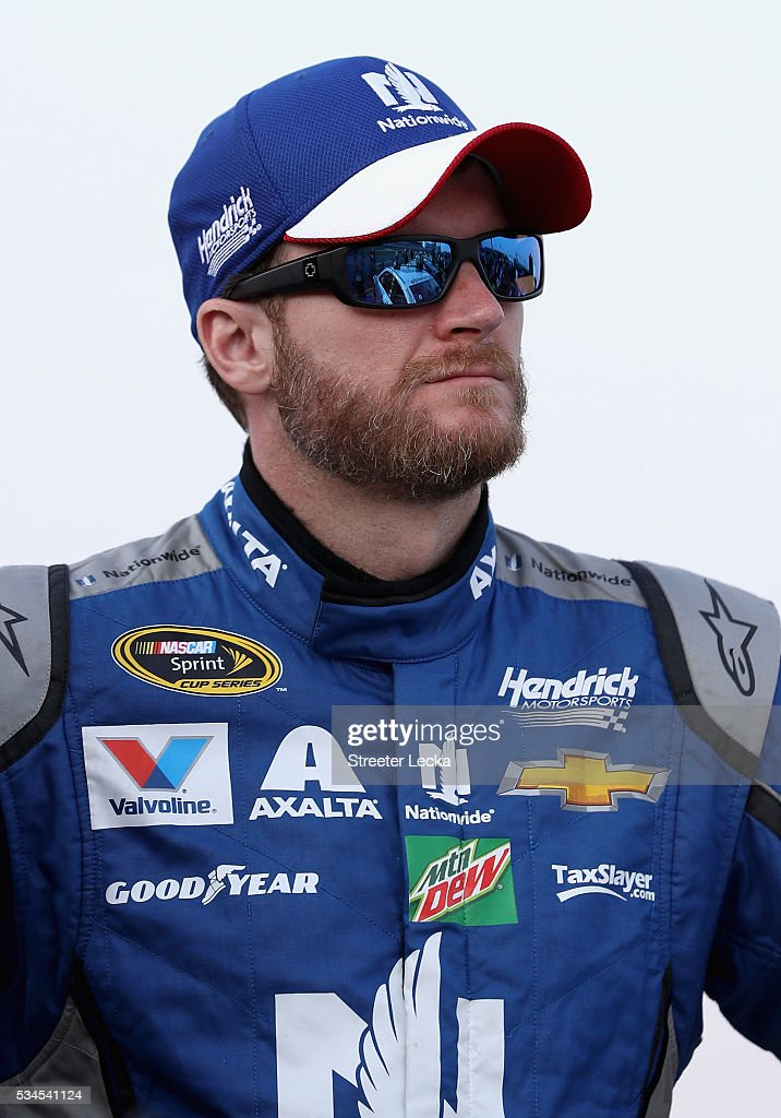 <a gi-track='captionPersonalityLinkClicked' href=/galleries/search?phrase=Dale+Earnhardt+Jr.&family=editorial&specificpeople=171293 ng-click='$event.stopPropagation()'>Dale Earnhardt Jr.</a>, driver of the #88 Nationwide Chevrolet, stands on the grid during qualifying for the NASCAR Sprint Cup Series Coca-Cola 600 at Charlotte Motor Speedway on May 27, 2016 in Charlotte, North Carolina.