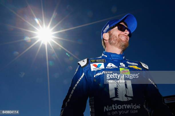 Dale Earnhardt Jr driver of the Nationwide Chevrolet stands on the grid prior to the 59th Annual DAYTONA 500 at Daytona International Speedway on...