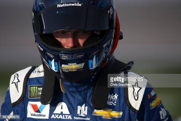 Dale Earnhardt Jr driver of the Nationwide Chevrolet stands on the grid during qualifying for the Monster Energy NASCAR Cup Series Kobalt 400 at Las...