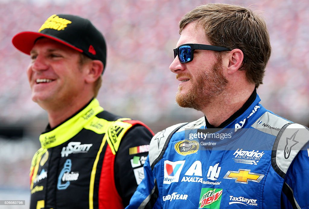Dale Earnhardt Jr, driver of the #88 Nationwide Chevrolet, talks to <a gi-track='captionPersonalityLinkClicked' href=/galleries/search?phrase=Clint+Bowyer&family=editorial&specificpeople=537951 ng-click='$event.stopPropagation()'>Clint Bowyer</a>, driver of the #15 AccuDoc Solutions Chevrolet, on the grid during qualifying for the NASCAR Sprint Cup Series GEICO 500 at Talladega Superspeedway on April 30, 2016 in Talladega, Alabama.