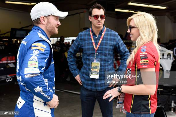 Dale Earnhardt Jr driver of the Nationwide Chevrolet talks to IndyCar driver Graham Rahal and his wife Courtney Force during practice for the Monster...