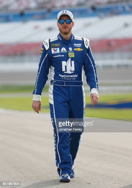 Dale Earnhardt Jr driver of the Nationwide Chevrolet walks down the grid during qualifying for the Monster Energy NASCAR Cup Series Kobalt 400 at Las...